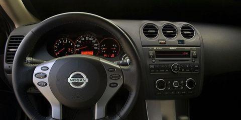 Automotive design, Product, Steering part, Steering wheel, White, Red, Speedometer, Gauge, Center console, Black,