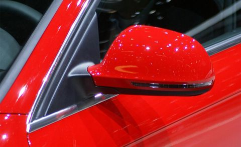 Motor vehicle, Automotive design, Automotive exterior, Red, Automotive mirror, Vehicle door, Glass, Carmine, Gloss, Bumper,