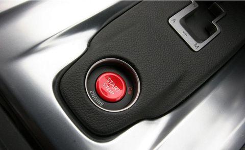 Automotive design, Logo, Technology, Portable communications device, Grey, Communication Device, Gadget, Luxury vehicle, Carbon, Mobile device,