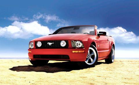 Motor vehicle, Automotive design, Blue, Natural environment, Hood, Automotive exterior, Headlamp, Automotive lighting, Landscape, Red,