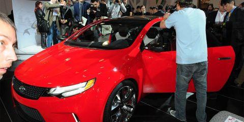 Automotive design, Vehicle, Event, Land vehicle, Car, Auto show, Exhibition, Mid-size car, Full-size car, Grille,