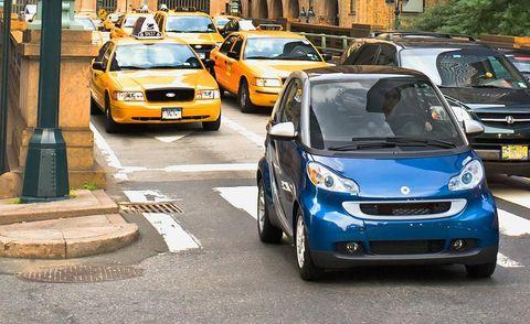 Motor vehicle, Wheel, Mode of transport, Automotive design, Land vehicle, Vehicle, Automotive parking light, Transport, Car, Taxi,