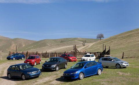 Wheel, Land vehicle, Vehicle, Automotive parking light, Car, Road, Highland, Hill, Alloy wheel, Terrain,