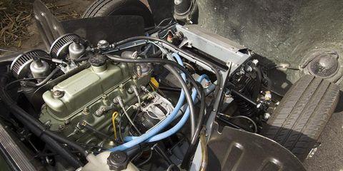 Engine, Automotive engine part, Automotive fuel system, Machine, Automotive super charger part, Fuel line, Nut, Automotive air manifold, Kit car, Classic,