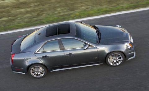 Tire, Wheel, Motor vehicle, Automotive tire, Road, Vehicle, Alloy wheel, Automotive design, Land vehicle, Rim,