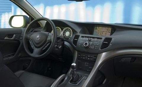Motor vehicle, Steering part, Mode of transport, Steering wheel, Automotive design, Automotive mirror, Transport, Center console, Vehicle audio, White,