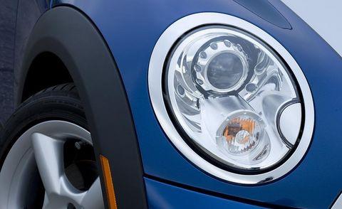 Motor vehicle, Automotive design, Automotive lighting, Headlamp, Automotive parking light, Automotive exterior, Alloy wheel, Grille, Automotive tire, White,