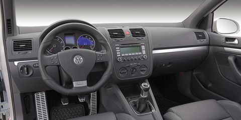 Motor vehicle, Steering part, Automotive design, Product, Steering wheel, Transport, Center console, White, Car, Vehicle audio,