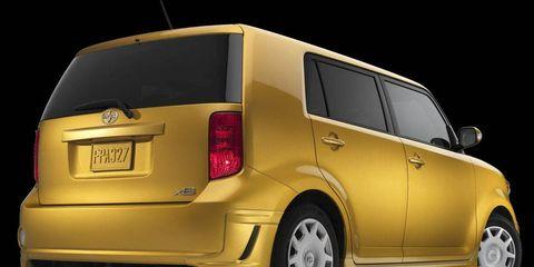 Motor vehicle, Mode of transport, Automotive design, Automotive mirror, Automotive tail & brake light, Automotive exterior, Vehicle, Yellow, Automotive lighting, Transport,