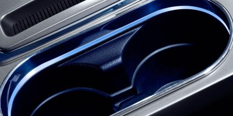 Motor vehicle, Automotive design, Automotive exterior, Electric blue, Logo, Metal, Luxury vehicle, Vehicle door, Personal luxury car, Steel,