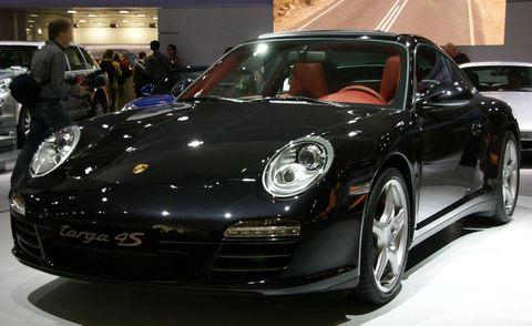 Automotive design, Vehicle, Land vehicle, Car, Rim, Alloy wheel, Performance car, Fender, Sports car, Personal luxury car,