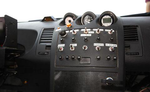 Transport, Steering part, Machine, Technology, Gauge, Steering wheel, Center console, Electronics, Speedometer, Tachometer,
