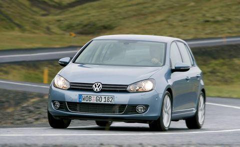 Automotive design, Road, Daytime, Vehicle, Transport, Car, Automotive mirror, Automotive wheel system, Rim, Headlamp,
