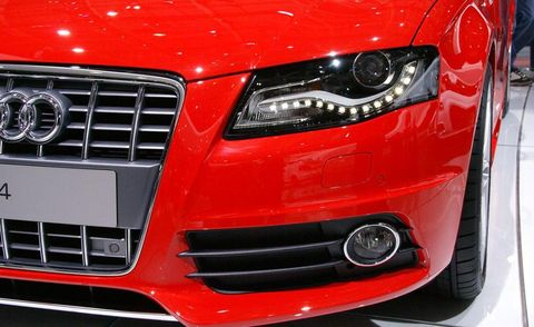 Automotive design, Vehicle, Automotive lighting, Headlamp, Grille, Hood, Car, Red, Automotive exterior, Bumper,