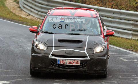 Automotive design, Vehicle, Car, Hood, Road surface, Grille, Headlamp, Motorsport, Asphalt, Racing,