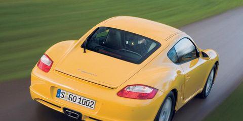 Yellow, Car, Landscape, Vehicle registration plate, Fender, Rim, Alloy wheel, Beauty, Bumper, Porsche,