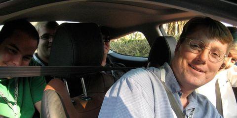 Vehicle door, Car seat, Head restraint, Steering wheel, Steering part, Automotive mirror, Car seat cover, Family car, Luxury vehicle, Automotive window part,