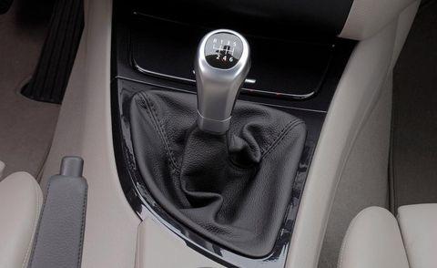 Motor vehicle, Automotive design, Gear shift, Vehicle door, Center console, Personal luxury car, Luxury vehicle, Car seat, Steering part, Steering wheel,