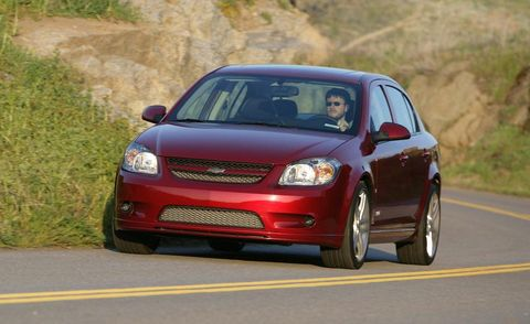Tire, Automotive design, Vehicle, Road, Land vehicle, Automotive mirror, Infrastructure, Car, Hood, Automotive lighting,