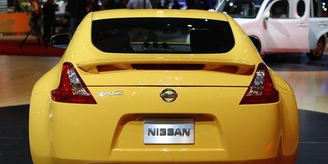 Motor vehicle, Automotive design, Vehicle, Yellow, Car, Red, Performance car, Automotive lighting, Vehicle registration plate, Sports car,