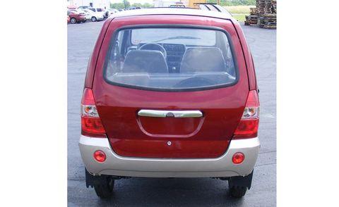 Motor vehicle, Automotive mirror, Vehicle, Automotive tail & brake light, Land vehicle, Glass, Automotive exterior, Car, Automotive lighting, Automotive parking light,