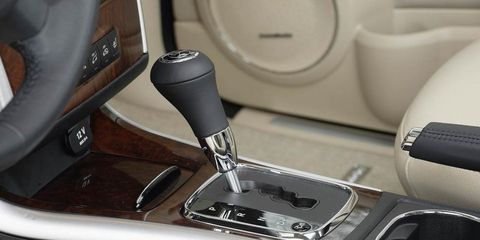 Gear shift, Luxury vehicle, Gloss, Center console, Audio accessory, Head restraint, Steering part, Silver, Car seat, Personal luxury car,