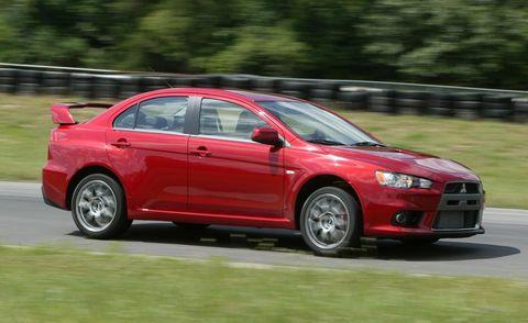 Tire, Wheel, Automotive design, Vehicle, Land vehicle, Car, Red, Mitsubishi, Alloy wheel, Mid-size car,