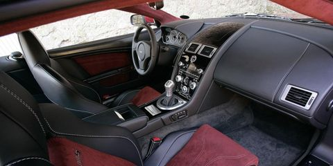 Motor vehicle, Mode of transport, Steering part, Steering wheel, Car seat, Center console, Car seat cover, Personal luxury car, Gear shift, Luxury vehicle,