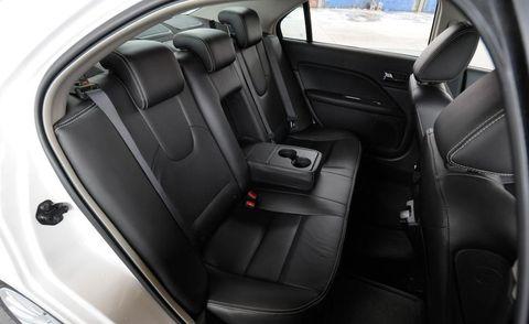 Motor vehicle, Car seat, Vehicle door, Car seat cover, Fixture, Luxury vehicle, Personal luxury car, Steering part, Head restraint, Steering wheel,