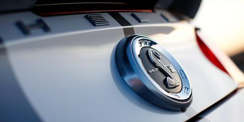 Motor vehicle, Automotive design, Logo, Symbol, Azure, Electric blue, Brand, Close-up, Emblem, Trademark,