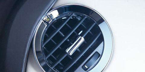 Automotive design, Metal, Carbon, Grille, Close-up, Circle, Steel, Trademark, Symbol, Silver,