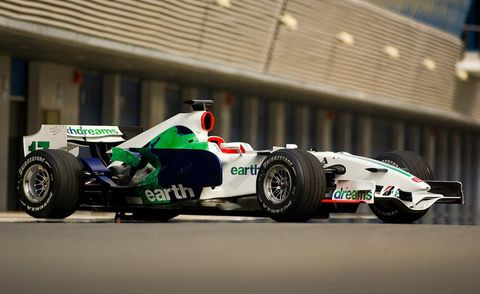 Tire, Wheel, Automotive tire, Automotive design, Open-wheel car, Formula one tyres, Automotive wheel system, Formula one car, Automotive exterior, Motorsport,