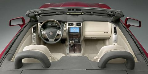 Motor vehicle, Mode of transport, Center console, Luxury vehicle, Personal luxury car, Steering wheel, Trunk, Gear shift, Steering part, Sports car,