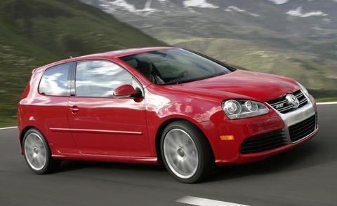 Motor vehicle, Automotive mirror, Automotive design, Vehicle, Hood, Car, Rim, Grille, Alloy wheel, Red,
