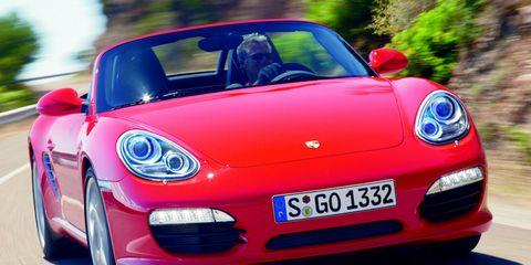 Automotive design, Mode of transport, Vehicle, Land vehicle, Transport, Car, Performance car, Red, Vehicle registration plate, Sports car,