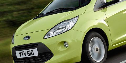 Tire, Motor vehicle, Wheel, Mode of transport, Automotive design, Automotive mirror, Vehicle, Automotive wheel system, Yellow, Transport,