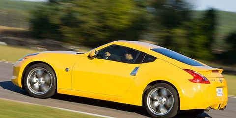 Tire, Wheel, Automotive design, Vehicle, Yellow, Automotive tire, Infrastructure, Rim, Car, Automotive wheel system,