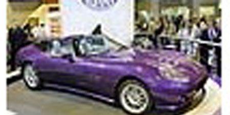 Motor vehicle, Tire, Wheel, Mode of transport, Automotive design, Transport, Automotive tire, Purple, Photograph, Car,