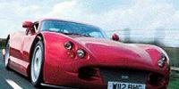 Motor vehicle, Mode of transport, Automotive design, Automotive mirror, Transport, Vehicle, Car, Red, Photograph, Automotive exterior,