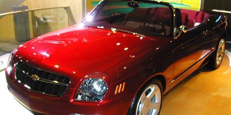 Tire, Wheel, Motor vehicle, Automotive mirror, Automotive design, Vehicle, Hood, Land vehicle, Grille, Car,