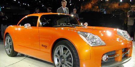 Tire, Wheel, Motor vehicle, Mode of transport, Automotive design, Vehicle, Yellow, Transport, Land vehicle, Car,
