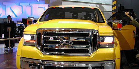 Motor vehicle, Automotive design, Vehicle, Yellow, Transport, Land vehicle, Grille, Headlamp, Automotive lighting, Car,