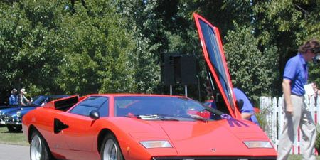 Mode of transport, Automotive design, Transport, Vehicle, Land vehicle, Car, Red, Automotive exterior, Hood, Fender,