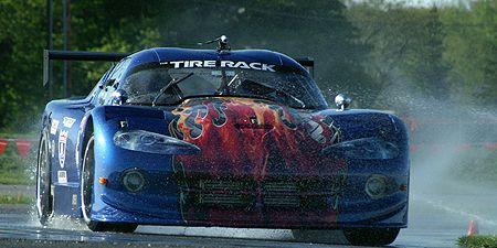 Tire, Automotive design, Vehicle, Land vehicle, Sports car racing, Hood, Headlamp, Motorsport, Car, Race track,
