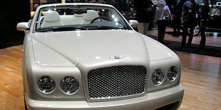 Vehicle, Hood, Land vehicle, Grille, Car, Headlamp, Automotive exterior, Automotive mirror, Personal luxury car, Luxury vehicle,