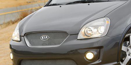 Automotive design, Daytime, Vehicle, Hood, Headlamp, Automotive lighting, Glass, Grille, Automotive mirror, Car,