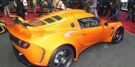 Tire, Wheel, Motor vehicle, Automotive design, Mode of transport, Vehicle, Yellow, Land vehicle, Performance car, Supercar,