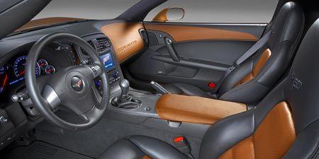 Motor vehicle, Mode of transport, Automotive design, Steering part, Vehicle, Steering wheel, White, Car, Car seat, Orange,