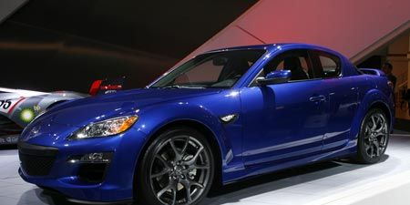 Tire, Wheel, Automotive design, Blue, Vehicle, Land vehicle, Automotive lighting, Car, Rim, Headlamp,