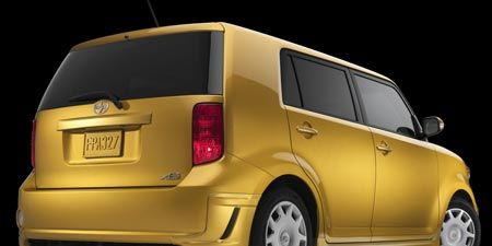 Motor vehicle, Mode of transport, Automotive mirror, Automotive design, Automotive tail & brake light, Vehicle, Automotive exterior, Yellow, Automotive lighting, Vehicle door,